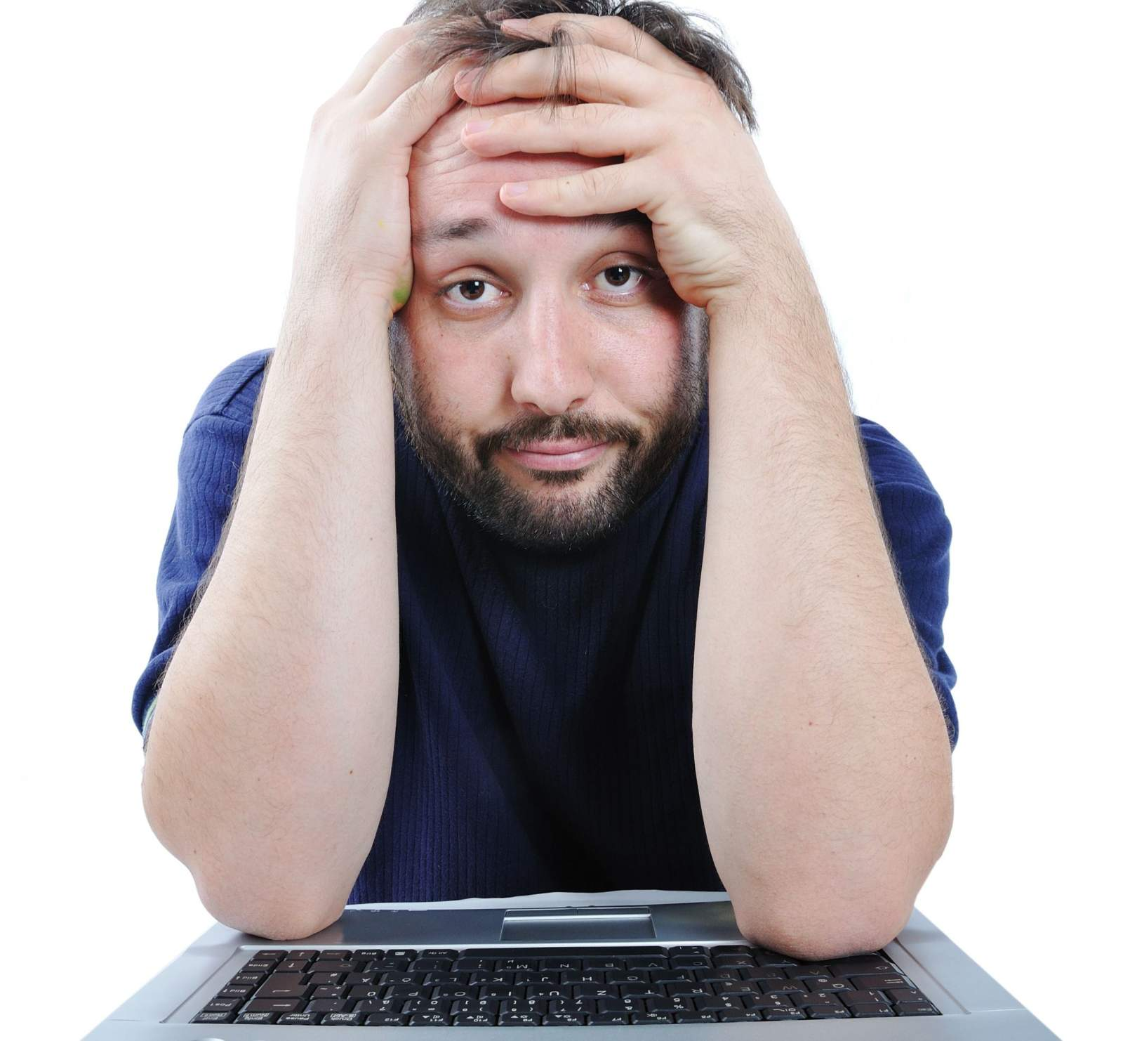 man annoyed looking at his computer screen